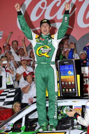 Kasey Kahne celebrates in victory lane after winning the NASCAR Sprint Cup Series Coca-Cola 600 auto race at Charlotte Motor Speedway, Sunday, May 27, 2012, in Concord, NC. (AP Photo/Autostock, Nigel Kinrade) MANDATORY CREDIT