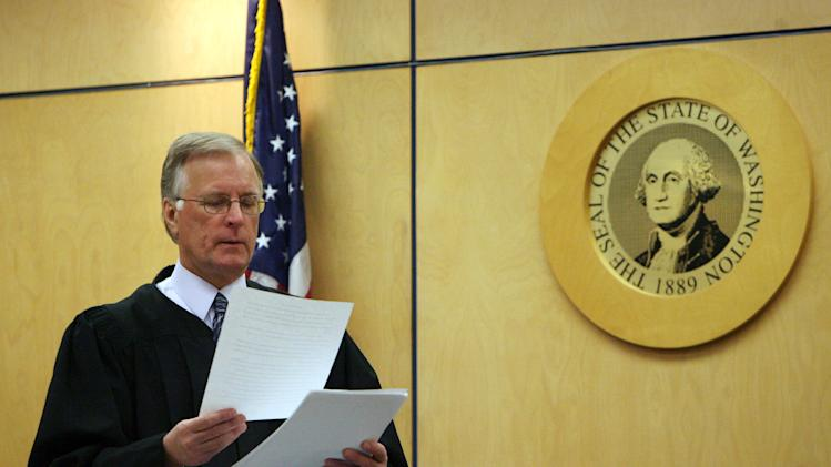 Judge Ronald Culpepper reads instructions to the jury in the voyeurism trial of Steve Powell, Tuesday, May 15, 2012, in Tacoma, Wash. Powell is the father-in-law of missing Utah mother Susan Powell. (AP Photo/The Salt Lake Tribune, Steve Griffin)  DESERET NEWS OUT; LOCAL TV OUT; MAGS OUT