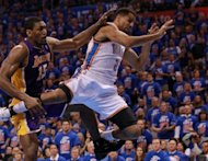 Los Angeles Lakers' Metta World Peace (L) fouls Oklahoma City Thunder's Thabo Sefolosha during game five of their NBA Western Conference series on May 21. The Thunder now face the top-seeded San Antonio Spurs for a place in the NBA finals