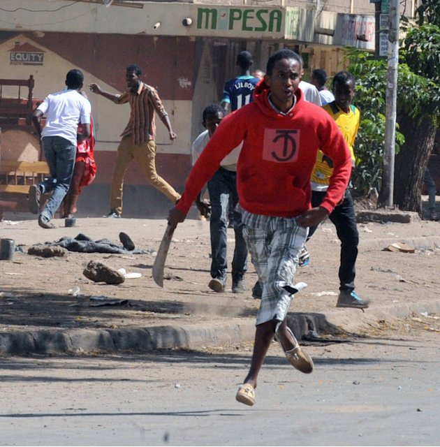 A Somali  man with a machete in  a street in Eastleigh, Nairobi, Kenya, Monday, Nov. 19, 2012. Police in Kenya have fired bullets into the air and tear gas into the streets to stop two groups from cla