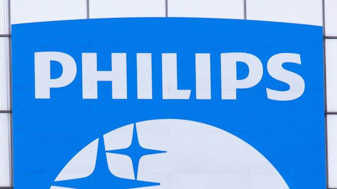 "FILE - In this Jan. 9, 2014 file photo, the company logo of Royal Philips NV sits on the head office in Amsterdam.  Royal Philips NV is to split off its lighting division to create two separate companies, the latest in a string of radical restructurings by one of Europe's best-known corporations. Philips, which began as a lighting company back in 1891, said Tuesday, Sept. 23, 2014, that ""independence"" would make it easier for the lighting arm, widely regarded as the dominant seller of LED lighting products, to enter new markets. (AP Photo/Peter Dejong, File)"