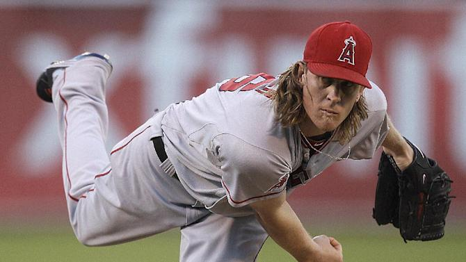 Los Angeles Angels' Jered Weaver works against the Oakland Athletics in the first inning of a baseball game Monday, Aug. 6, 2012, in Oakland, Calif. (AP Photo/Ben Margot)