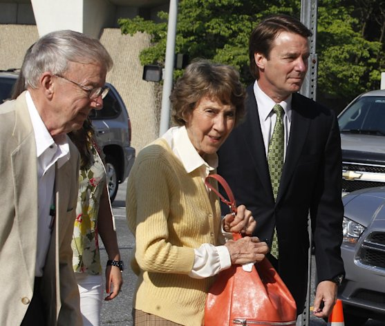 Former Sen. John Edwards, right, leads his mother Bobbie Edwards, center, and father Wallace Edwards, into the Federal Courthouse in Greensboro, N.C. Wednesday, May 2, 2012. Edwards is accused of conspiring to secretly obtain more than $900,000 from two wealthy supporters to hide his extramarital affair with Rielle Hunter and her pregnancy from the media. He has pleaded not guilty to six charges related to violations of campaign-finance laws. (AP Photo/The News & Observer, Chuck Liddy)