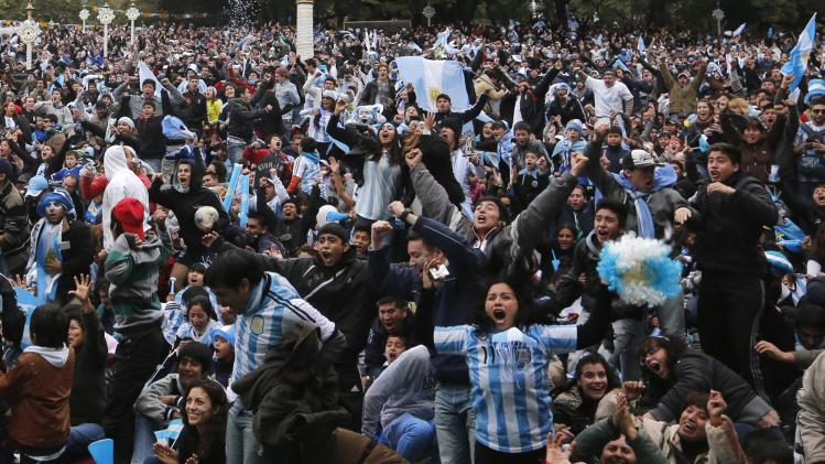 Argentina soccer fans gather at a public square to celebrate Argentina's win over Iran in their 2014 World Cup Group F soccer match, in Buenos Aires