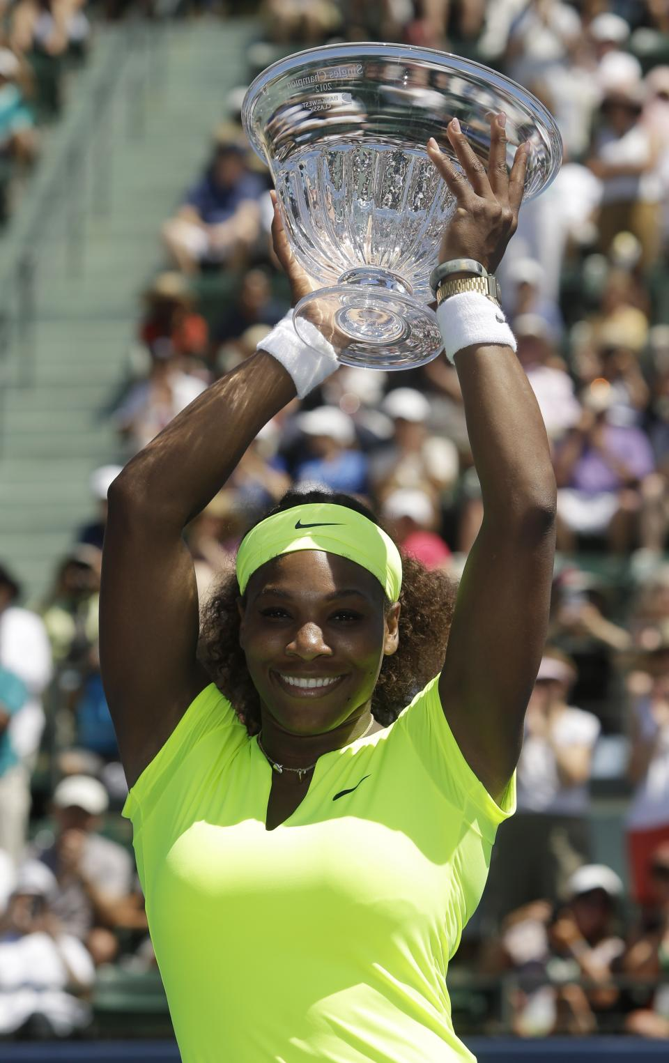 Serena Williams, of the United States, holds the winner's trophy after defeating Coco Vandeweghe, of the United States, during the final of the Bank of the West tennis tournament on Sunday, July 15, 2012, in Stanford, Calif.  Williams won 7-5, 6-3. (AP Photo/Marcio Jose Sanchez)