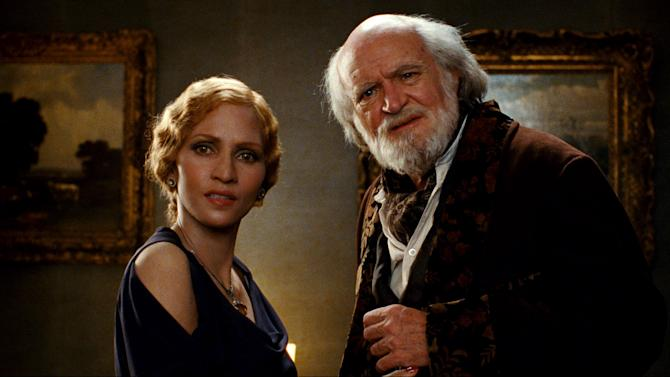 """This film image released by Warner Bros. Pictures shows Halle Berry, left, and Jim Broadbent in a scene from """"Cloud Atlas,"""" an epic spanning centuries and genres. (AP Photo/Warner Bros. Pictures, Reiner Bajo)"""