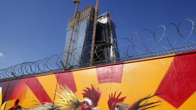 Graffiti is seen on the fence around of the construction site of the new headquarters of the European Central Bank in Frankfurt, Germany, Monday, Oct. 1, 2012.  The meeting of the ECB governing council will be held on Thursday in Slovenia. (AP Photo/Michael Probst)