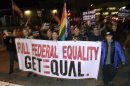 File photo of people carrying a banner during a march celebrating a U.S. appeals court ruling on Proposition 8 in West Hollywood