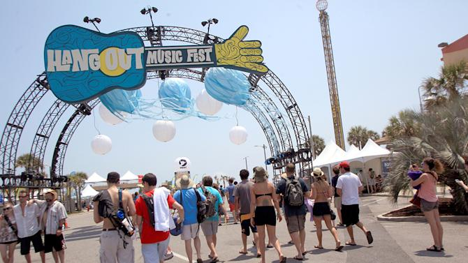 FILE - This May 20, 2011 file photo shows festival goers arrive for the three day Hangout Music Festival in Gulf Shores, Ala. Despite heat, humidity, crowds and costs, music festivals are more popular than ever, attracting millions of fans, with 270 festivals of various types annually in the U.S. and more than 800 in 57 countries. (AP Photo/Mobile Press-Register, Kate Mercer, file)
