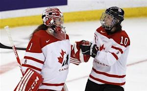 Canada's Szabados and Apps celebrate defeating Russia in their semi-final game at the IIHF Ice Hockey Women's World Championship in Ottawa