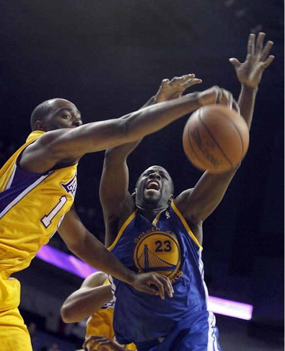 Los Angeles Lakers forward Marcus Landry, left, battles Golden State Warriors forward Draymond Green, right, for a rebound in the fourth quarter in an NBA basketball preseason game Saturday, Oct. 5, 2