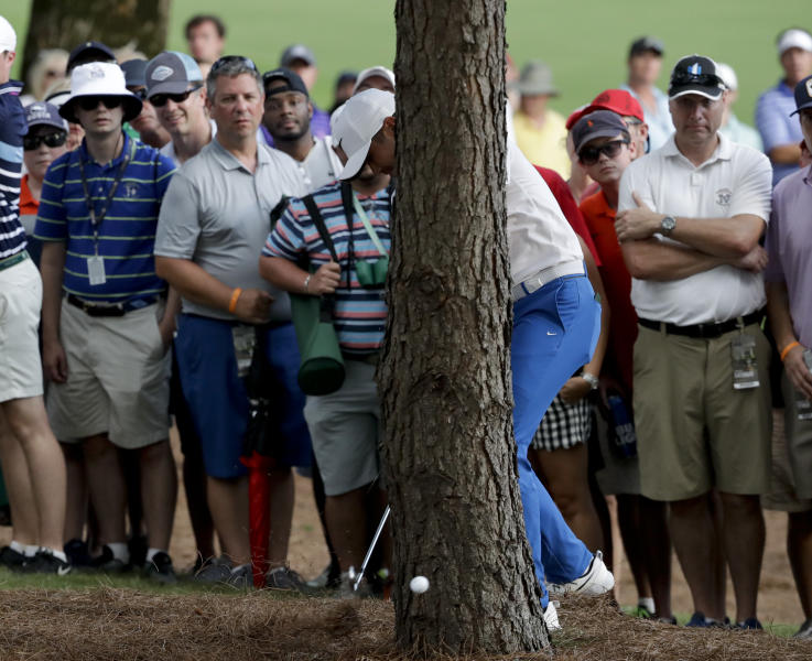 """<a class=""""yom-entity-link yom-entity-sports_player"""" href=""""/pga/players/7542/"""">Jason Day</a> hits from behind a tree on the 18th hole during the third round of the PGA Championship. (AP)"""