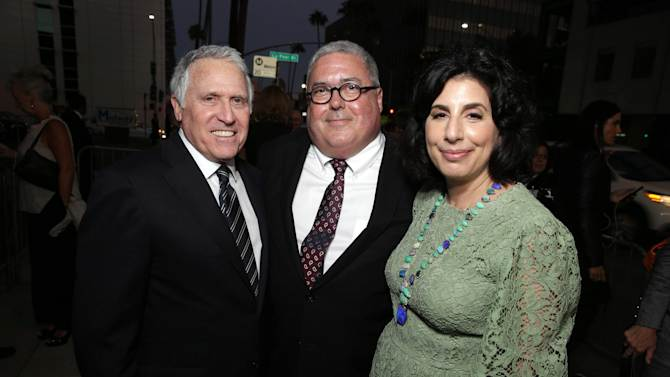 "Dan Fellman, President of Domestic Distribution for Warner Bros. Pictures, Bruce Berman, Chairman and CEO of Village Roadshow Pictures and producer and Sue Kroll, President of Worldwide Marketing and International Distribution at Warner Bros. Pictures seen at Warner Bros. Picture's Los Angeles Premiere of ""The Judge"" held at Samuel Goldwyn Theatre, AMPAS on Wed, Oct 1, 2014, in Los Angeles. (Photo by Eric Charbonneau/Invision for Warner Bros./AP Images)"
