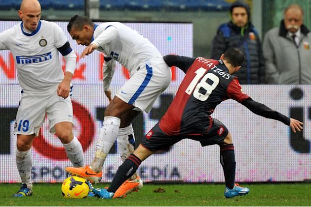 Inter Milan's Juan Jesus of Brazil, left, vies for the ball with Genoa's Giannis Fetfatzidis of Greece, during a Serie A soccer match at Genoa's Luigi Ferraris Stadium, Italy, Sunday, Jan.