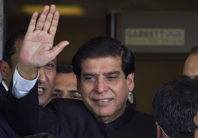 Pakistan&#39;s Prime Minister Raja Pervaiz Ashraf waves upon his arrival at the Supreme Court for a hearing in Islamabad, Pakistan on Monday, Aug. 27, 2012. Ashraf appeared at Supreme Court to explain why he has not followed instructions from a panel of judges to reopen an old corruption case against the country&#39;s president, Asif Ali Zardari. (AP Photo/Anjum Naveed)