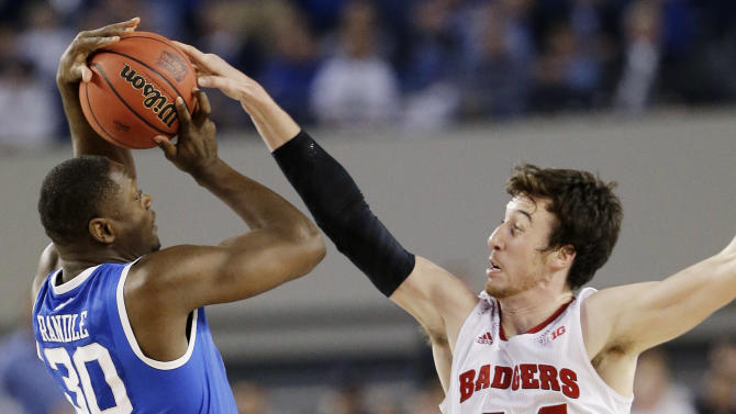 Wisconsin forward Frank Kaminsky (44) blocks a shot by Kentucky forward Julius Randle (30) during the second half of the NCAA Final Four tournament college basketball semifinal game Saturday, April 5, 2014, in Arlington, Texas