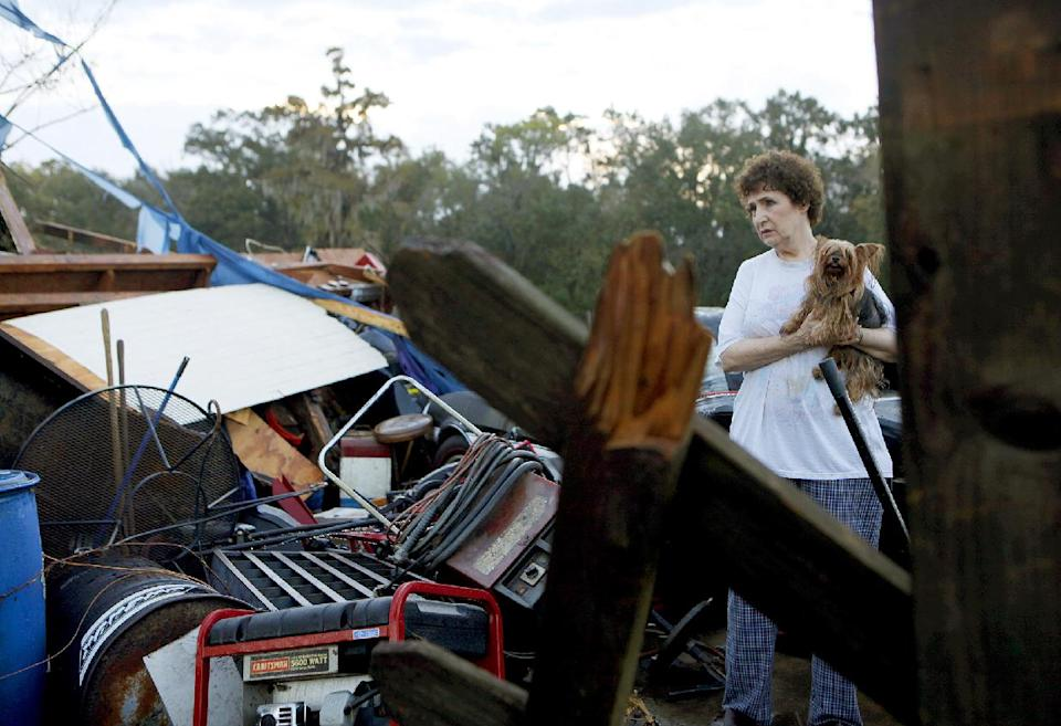 Diane Pierce, 69, stands near her shed, which was demolished by strong winds from a suspected tornado Wednesday, Nov. 16, 2011 on Piping Rock Drive in Houma, La. No one was injured. (AP Photo/ Julia Rendleman, The Houma Courier)