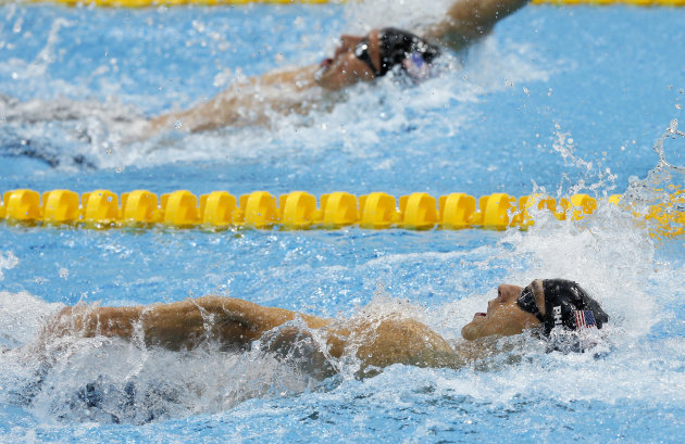 United States' Michael Phelps leads compatriot Ryan Lochte in the men's 200-meter individual medley swimming final at the Aquatics Centre in the Olympic Park during the 2012 Summer Olympics in London, Thursday, Aug. 2, 2012. (AP Photo/Daniel Ochoa De Olza)
