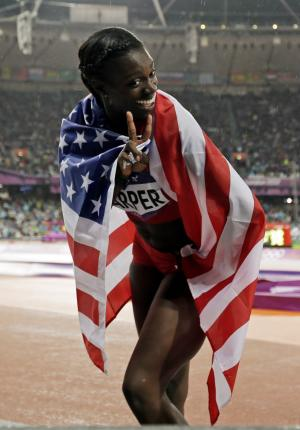 USA's Dawn Harper celebrates her silver medal win in the women's 100-meter hurdles during the athletics in the Olympic Stadium at the 2012 Summer Olympics, London, Tuesday, Aug. 7, 2012. (AP Photo/Matt Slocum)