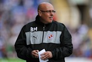 Brian McDermott, pictured, has earned praise from Arsene Wenger