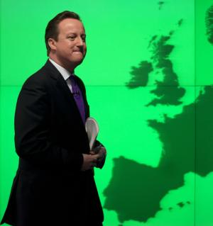 """Britain's Prime Minister David Cameron walks past a map of Europe on a screen as he walks away after making a speech on holding a referendum on staying in the European Union in London, Wednesday, Jan. 23, 2013. Cameron said Wednesday he will offer British citizens a vote on whether to leave the European Union if his party wins the next election, a move which could trigger alarm among fellow member states. He acknowledged that public disillusionment with the EU is """"at an all-time high,"""" using a long-awaited speech in central London to say that the terms of Britain's membership in the bloc should be revised and the country's citizens should have a say. (AP Photo/Matt Dunham)"""