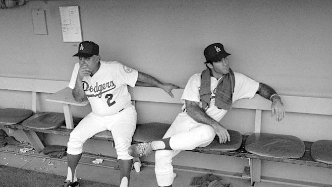 FILE - In this Oct. 6, 1980, file photo, Los Angeles Dodgers manager Tommy Lasorda, left, and first baseman Steve Garvey sit in the dugout after their 7-1 loss to the Houston Astros in a baseball game for the National League West title in Los Angeles. The Dodgers took three in a row from the Astros in the final series of the regular season to knot things up atop the division, but they fell short in this tiebreaker. The Associated Press takes a look at the nine one-game playoffs in major league history. (AP Photo/File)
