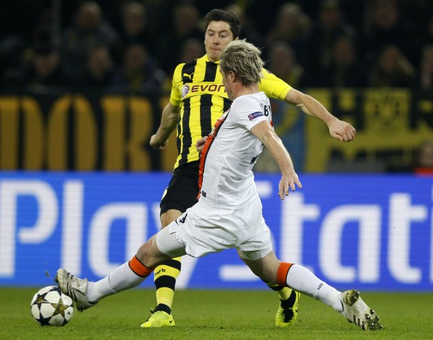 Borussia Dortmund's Lewandowski is tackled by Shakhtar Donetsk's Huebschman during their Champions League soccer match in Dortmund