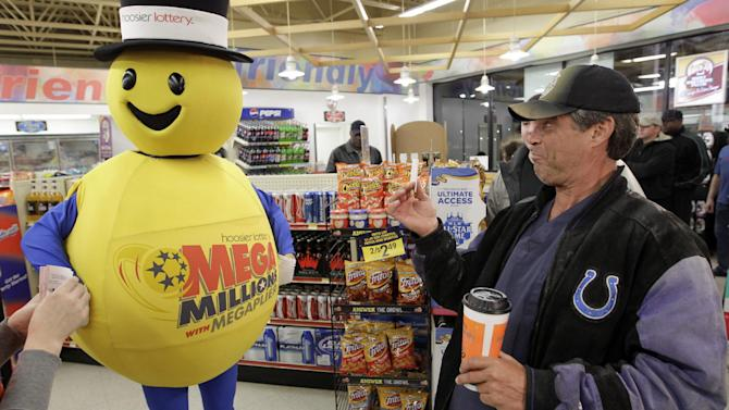 A customer smiles after receiving a free Mega Millions Lottery ticket from the Hoosier Lottery's Mega Millions mascot at a store in Zionsville, Ind., Friday, March 30, 2012. The Mega Millions Lottery jackpot has reached more than $600 million. (AP Photo/Michael Conroy)