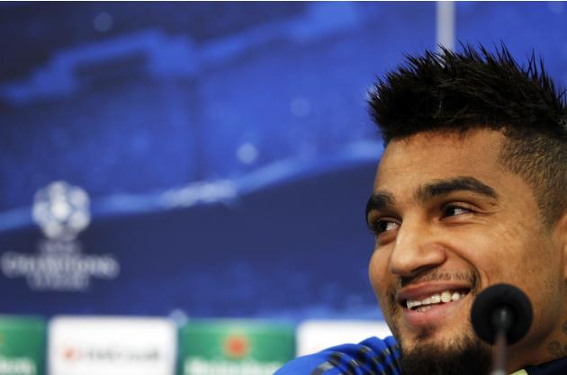 Schalke 04's Boateng smiles during a news conference in Gelsenkirchen