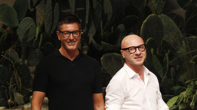 FILE -- In this file photo taken on June 23, 2012, Italian fashion designers Stefano Gabbana, left, and Domenico Dolce take the catwalk after presenting their Dolce & Gabbana fashion collection in Milan, Italy. A Milan court convicted fashion designers Domenico Dolce and Stefano Gabbana of tax evasion. The pair were found guilty Wednesday of failing to declare euros 1 billion ($1.3 billion) in income to authorities. The court sentenced them both to one year and eight months in jail. Prosecutors argued that the pair had evaded taxes on income of 416 million euros each and 200 million euros through a Luxembourg-based company. The statute of limitations ran out on a charge of misrepresenting income. (AP Photo/Luca Bruno)
