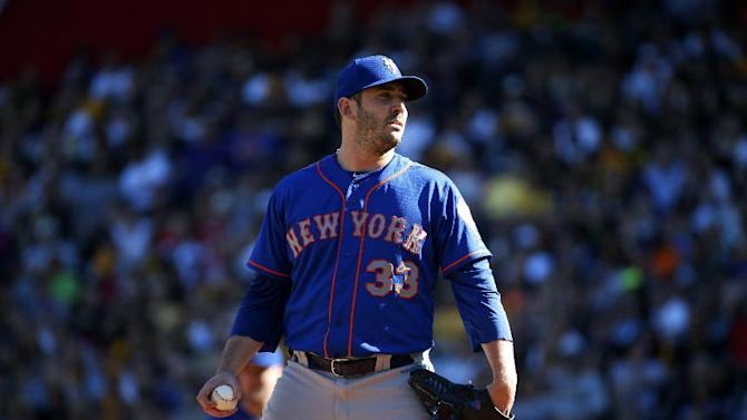 New York Mets starting pitcher Matt Harvey (33) stands on the mound after giving up a two-run double to Pittsburgh Pirates' Josh Harrison in the fourth inning of a baseball game in Pittsburgh, Saturday, May 23, 2015. (AP Photo/Gene J. Puskar)