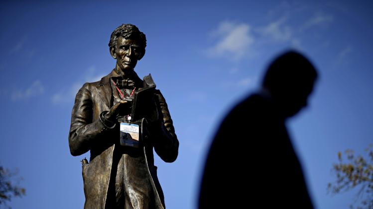 A personalized Abraham Lincoln credential  for Thursday's vice presidential debate hangs on a statue of Lincoln, Wednesday, Oct. 10, 2012, at Centre College in Danville, Ky. (AP Photo/David Goldman)