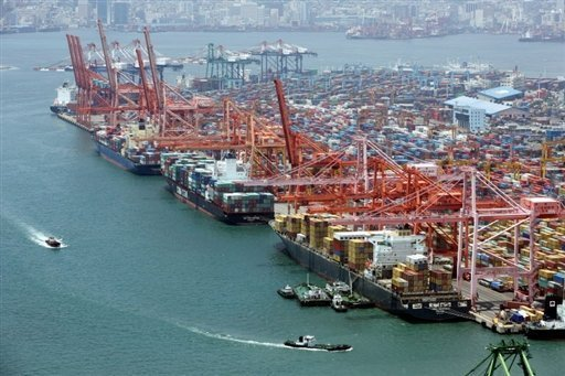 File photo of container ships being loaded in the southern port of Busan. South Korea's exports fell sharply in July compared to a year earlier, official figures showed Wednesday,