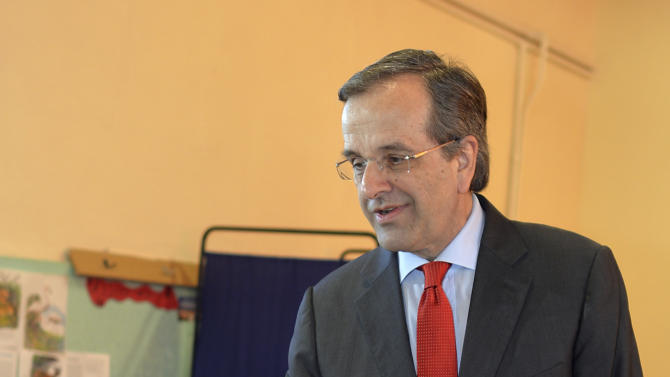 Greece's Prime Minister Antonis Samaras casts his vote at a polling station in Pylos, southern Greece, Sunday, Jan. 25, 2015. Greeks were voting Sunday in an early general election crucial for the country's financial future, with the radical left Syriza party of Alexis Tsipras tipped as the favorite to win, although possibly without a large enough majority to form a government. (AP Photo/Nikitas Kotsiaris)