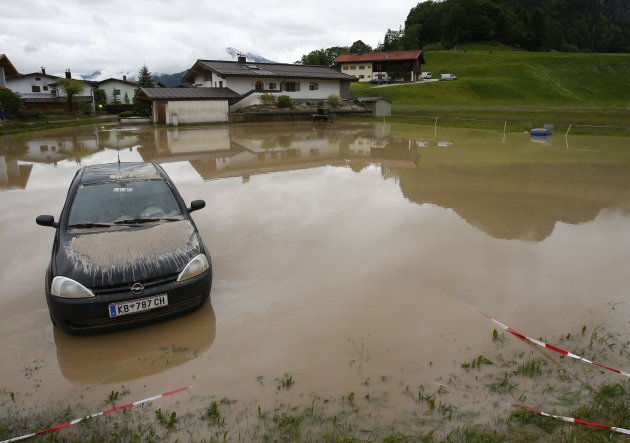 A damaged car is pictured in the flooded western Austrian village of Koessen