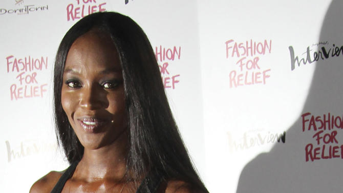 FILE - In this Aug 9, 2012 file photo, British model Naomi Campbell arrives for a Fashion For Relief dinner at Downtown restaurant in central London. Naomi Campbell is pulling out all the stops to celebrate the birthday of her boyfriend, Russian billionaire Vladimir Doronin, in the palaces of western India. The birthday celebration kicked off on Tuesday night, Nov. 6, 2012. (AP Photo/Joel Ryan, File)