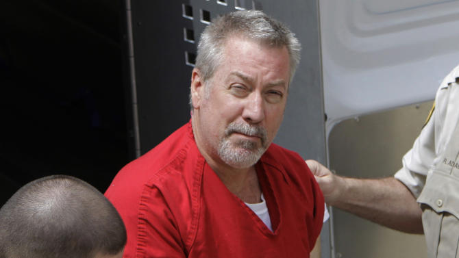 FILE - In this May 8, 2009 file photo, former Bolingbrook, Ill., police sergeant Drew Peterson arrives at the Will County Courthouse in Joliet, Ill., for his arraignment on charges of first-degree murder in the 2004 death of his third wife Kathleen Savio. On Thursday, Feb. 21, 2013, Will County Judge Edward Burmila refused to grant Peterson a new murder trial in the death of his third wife. The ruling came after Peterson's current legal team argued for a new trial on grounds his former lead attorney botched the case. After the ruling, the judge moved on to Peterson's sentencing hearing. (AP Photo/M. Spencer Green, File)