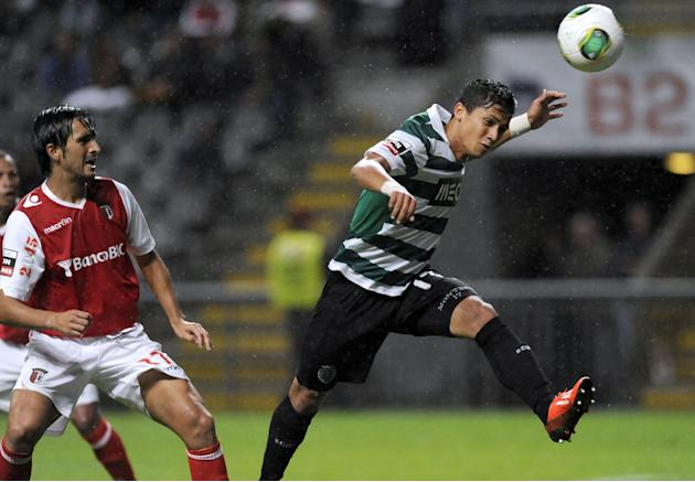 Sporting's Fredy Montero, from Colombia, goes for the ball past Sporting Braga's Custodio Castro, left, during their Portuguese League soccer match at the Municipal Stadium, in Braga, Portugal, Saturd