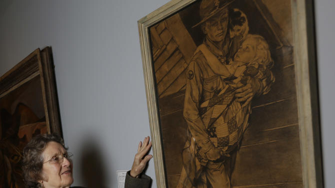 """Mary Immen Hall of Bennington, Vt., poses with the 1940 Norman Rockwell illustration """"A Scout is Helpful"""" for which she modeled at the Bennington Museum on Friday, Sept. 28, 2012, in Bennington, Vt. (AP Photo/Mike Groll)"""
