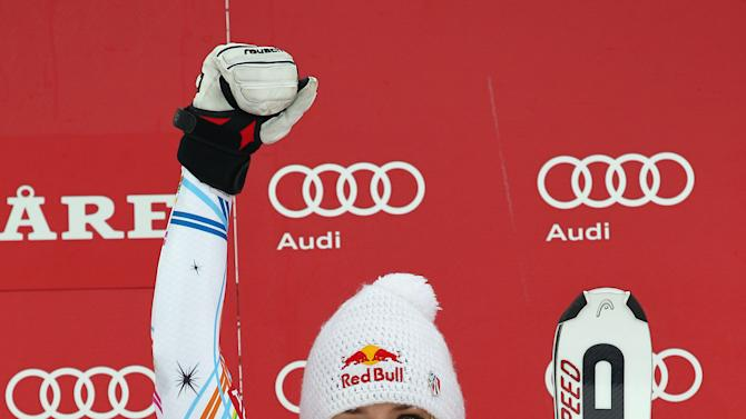 United States's Lindsey Vonn celebrates on podium after winning a women's Alpine Ski World cup giant slalom competition in Are, Sweden, Friday, March 9, 2012. (AP Photo/Alessandro Trovati)