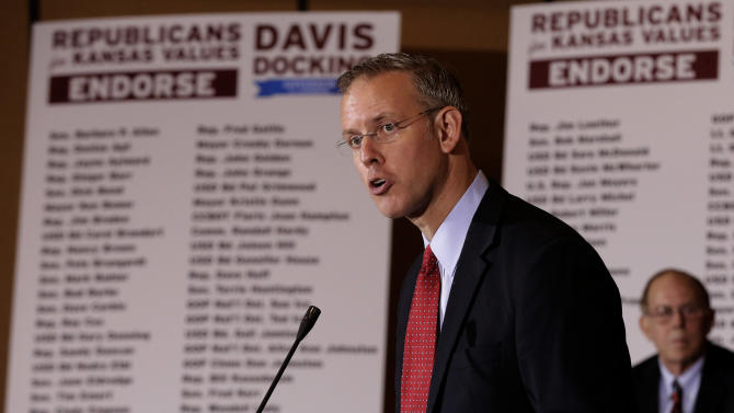 Paul Davis speaks at a news conference, Tuesday
