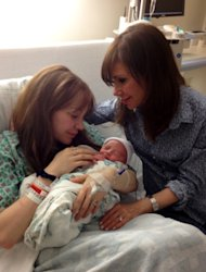 "This Feb. 13, 2012 image released courtesy of Heidi Murkoff shows Emma Bing, left, holding her son Lennox Page Ali as her mother, author Heidi Murkoff, looks on at a hospital in Los Angeles. Bing, the inspiration for the pregnancy bible ""What to Expect When You're Expecting,"" gave birth on Feb. 12. Heidi Murkoff was pregnant with Emma when she wrote the proposal for her best-selling book, which sparked a franchise of pregnancy and parenting manuals. ""What to Expect"" has more than 17 million copies in print. (AP Photo/Erik Murkoff)"