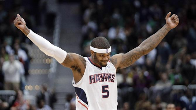 Atlanta Hawks forward Josh Smith reacts after a Hawks basket in the second half of an NBA basketball game against the Boston Celtics on Friday, Jan. 25, 2013, in Atlanta. Atlanta won 123-111 in double-overtime. (AP Photo/John Bazemore)