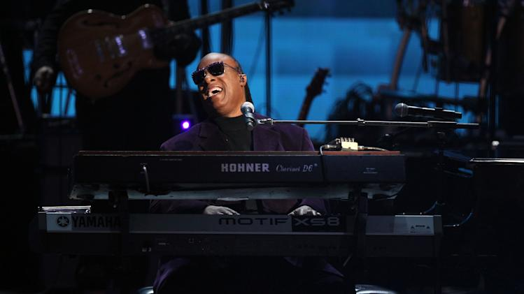 """Stevie Wonder and the Rickey Minor Band perform """"Master Blaster"""", """"My Cherie Amour"""" and """"Sir Duke"""" as a tribute to Dick Clark at the 40th Anniversary American Music Awards on Sunday, Nov. 18, 2012, in Los Angeles. (Photo by Matt Sayles/Invision/AP)"""