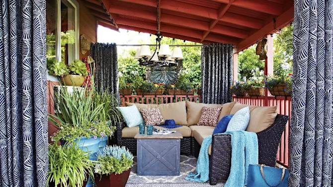 This publicity photo provided by Brian Patrick Flynn shows furniture of this outdoor living room designed by Brian Patrick Flynn for Hayneedle.com that is arranged around an outdoor chandelier. Flynn often uses outdoor chandeliers in covered outdoor spaces to give exterior spaces the look and feel of a homey, indoor room. (AP Photo/Brian Patrick Flynn, Daniel J. Collopy)