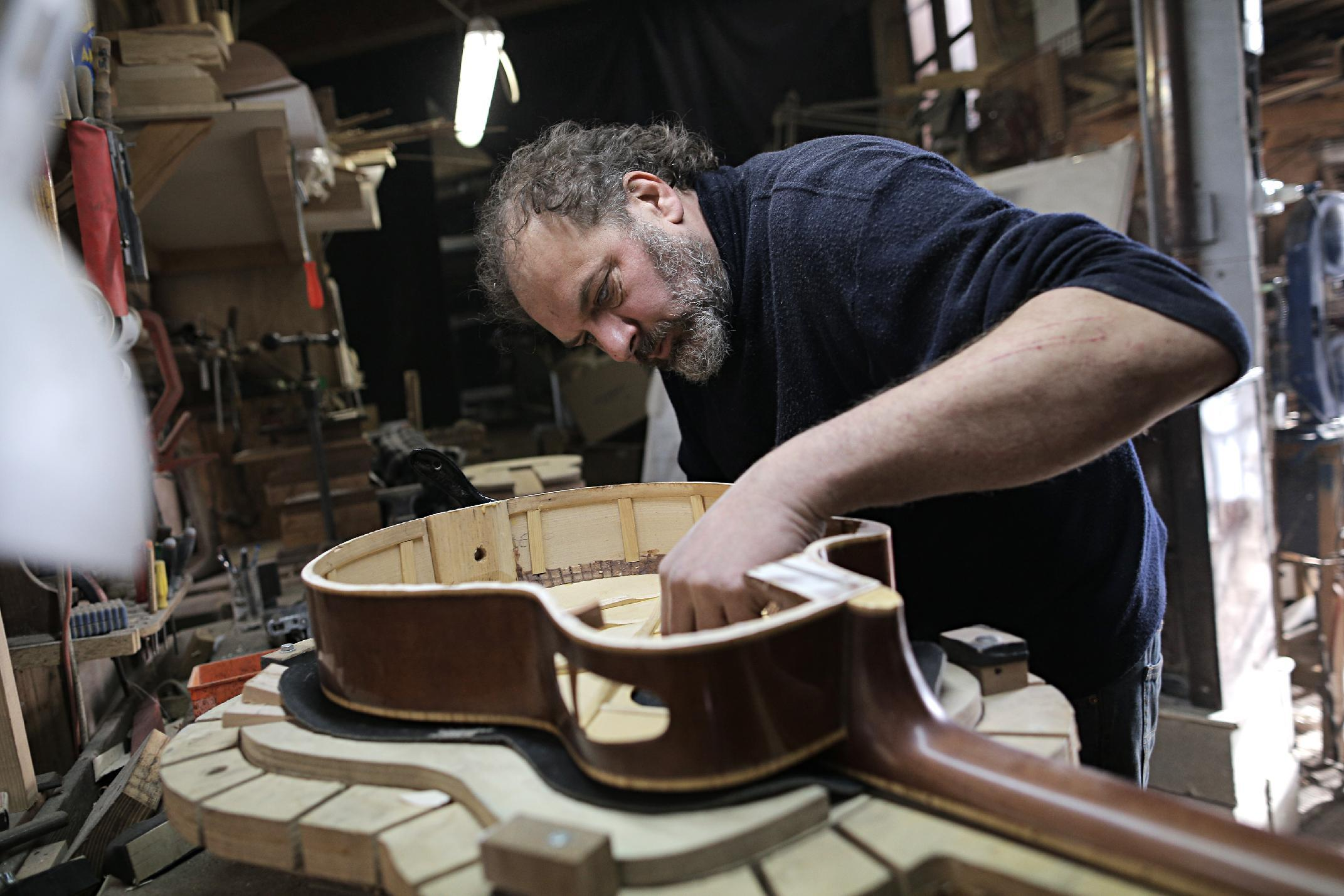Italy artisan crafts guitars for musicians in need