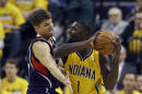 Indiana Pacers' Lance Stephenson (1) is defended by Atlanta Hawks' Kyle Korver during the first half in Game 1 of an opening-round NBA basketball playoff series on Saturday, April 19, 2014, in Indianapolis. (AP Photo/Darron Cummings)