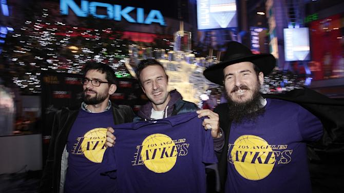 IMAGE DISTRIBUTED FOR AEG - From left, Chaim Marcus, David Arquette and Chabad's Rabbi Cunin pose for a photo during AEG's Season of Giving celebrates Chanukah with David Arquette and Chabad's Rabbi Cunin on Sunday, Dec. 9, 2012 in Los Angeles. (Photo by Joe Kohen/Invision for AEG/AP Images)