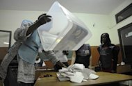 An Angolan electoral agent starts counting votes in Viana on the outskirts of Luanda. President Jose Eduardo dos Santos on Sunday held a massive lead in Angola's general elections with more than 70 percent of the vote counted, but the opposition said it was gathering evidence of fraud