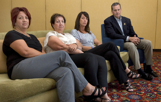 In this Sunday, Sept. 16, 2012 photo, members of Brian Terry&#39;s family, from left to right, Michelle Balogh, left, Josephine Terry, Kelly Willis and Robert Heyer, far right, pose at the Marriott-Starr Pass Resort in Tucson, Ariz. Family members of Terry, an Arizona U.S. Border Agent killed in connection with a botched gun-smuggling operation, say they won&#39;t have closure until someone is held accountable for his death. (AP Photo/John Miller)